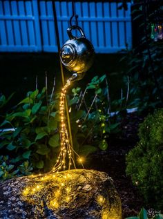 DIY Spilling Solar Lights {Teapot Lights}   Easy, budget friendly and one of a kind DIY backyard ornament and landscape lights   Upcycled teapot   Step-by-step tutorial for DIY spilling solar lights {Teapot solar lights}   DIY whimsical garden lights   Before & After   TheNavagePatch.com