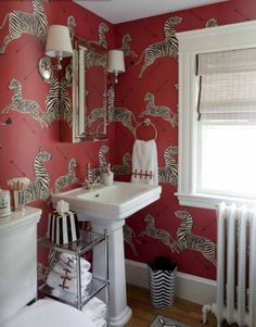 I love the idea of a bold wallpaper in a powder room. Scalamandre Zebra is one of my faves.