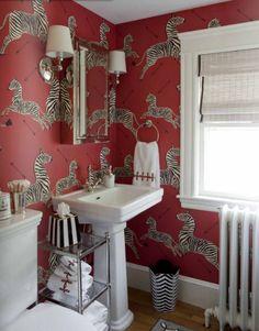 Bathroom. Powder Room. Red zebra scalamandre wallpaper. Zebra wastebasket.