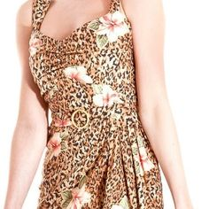 Pin up leopard sz14uk large us nwts Such a cute pin up style leopard dress.  Size 14 uk and large us.  Brand new tags attached Dresses Midi