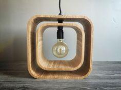 Lamp by Loupiotte Design #wood #design « Giru » signifie en corse « faire un tour ». La lampe se compose de deux cubes en bois, celui du centre est mobile. Les deux cubes sont reliés par un tube et des écrous en laiton, qui lui permet une rotation à 360°, modulant ainsi l'ambiance et l'intensité de votre lumière. Taille de la lampe : 32/32cm, profondeur: 15,5cm Ampoule globe Edison filaments carbones : 40W