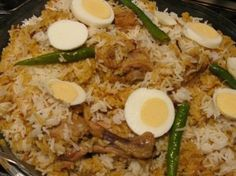 "Chicken Biriyani - a 1 dish desi party starter... soo worth the time, effort and cost of making this... Must use ""Kali jera"" (black cumin) rice but if you can't find it at the local indo-pak stores you can use basmati rice."