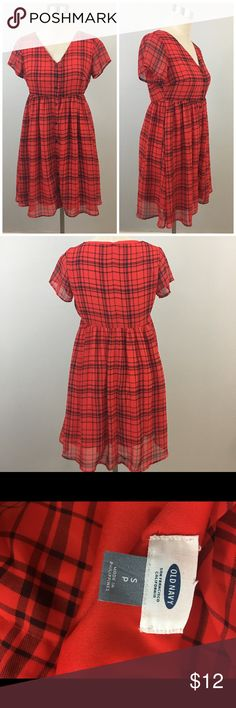 """Red & Black Plaid Button Up Baby Doll Style Dress Red & Black Plaid Button Up Baby Doll Style Dress. Size small with slight stretch. Dress fully buttons and has lining. Hits slightly above the knee in length. Thank you for looking at my listing. Please feel free to comment with any questions (no trades/modeling).  •Fabric: Polyester  •Length: 35""""  •Condition: Very good, no visible flaws.   ✨Bundle and save!✨10% off 2 items, 20% off 3 items & 30% off 5+ items! EB Old Navy Dresses Mini"""