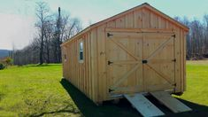 """We call this 12 x 24 Gable Board and Batten shed, the """"Big Boy"""". Custom made by West Quebec Shed Company, continue to use true cut framing other know as rough cut. True 2x6 flooring, 3/4 inch plywood floor,  2x4 wall studs, 2x6 roof rafters. Metal roof with the added Bubble insulation to the roof to decrease inside heat temperature by over 40% and stops frost drip in colder months. The specialized ramps can easily be disconnect with both the aluminum receiver and connector components. Custom Sheds, Board And Batten Siding, Small Cottages, Metal Roof, Rough Cut, Backyard, Outdoor Structures, Flooring, Garden"""