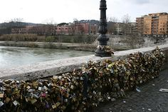 Ponte Milvio Bridge in Rome, Italy-- In late 2006, the bridge began attracting couples, who hang padlocks as a sign of their love. The ritual involves the couple locking the padlock, then throwing the key into the Tiber.