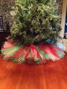 Christmas tree with one of Jenna's tutus! Do white tulle, with lights underneath. Red Christmas Tree Skirt Tulle by Bowsbaublesandbeads on Etsy (Wonder if the Cat would still be able to play under the tree with something like this. Merry Little Christmas, Christmas Love, All Things Christmas, Winter Christmas, Disney Christmas, Christmas Pictures, Christmas Angels, Christmas Ideas, Ribbon On Christmas Tree