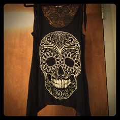 Scull tank top with lace back Black tank with black lace back and white scull design. ⭐️Willing to negotiate the price through the offer button.⭐️ Hot Topic Tops Tank Tops