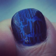 Close up on electric blue nails w/ black shatter top coat.