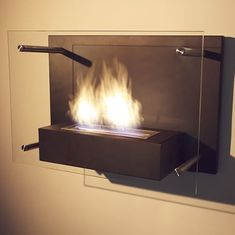 Come on baby, light my Radia Wall Mounted Fireplace . Ok, it may be a little too corny, but the Radia fireplace is definitely worthy of calling. Bioethanol Fireplace, Fireplace Mantels, Wall Fireplaces, Indoor Fireplaces, Modern Fireplaces, Wall Mounted Fireplace, Lowes Home, Fireplace Accessories, Bathroom Renos