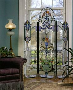 This stained glass room divider is just beautiful, and the focus of the room as natural light beams through the window and through the divider, highlighting the painted portions of the piece.