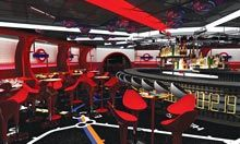 """The Tube The Tube, an adults-only nightclub located on Deck 4, Aft in the Europa district on the Disney Fantasy, transports Guests to a vibrant metropolitan club complete with an illuminated Union Jack dance floor, """"mod"""" furniture, popular cocktails and four iconic English phone booths."""
