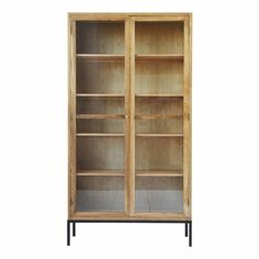 House Doctor Cosmo cabinet. The Cosmo cabinet is made of elm wood and has handy shelves. The doors have glass so you can nicely show your tableware. One of the highlights from the new House Doctor collection!