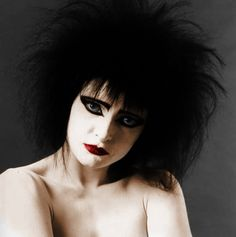 [A bust-length color photo of Siouxsie, nude and with white powdered skin, very black backcombed hair, and simple but heavy black eyeliner and very red lipstick.] She's so gorgeous I can't even. *talonflaily*