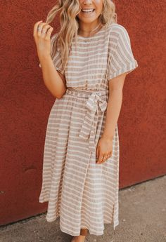 This dress is perfect for running errands or going out on a date night! The tie is so flattering and we love the subtle color in the stripes! Long Summer Dresses, Summer Dress Outfits, Day Dresses, Cute Dresses, Skirt Outfits, Dress Summer, Winter Outfits, Modest Dresses Casual, Modest Outfits