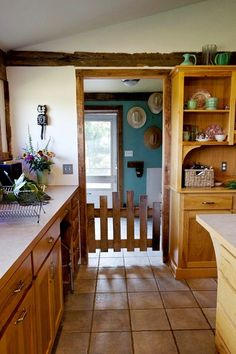 little gate is adorable would be perfect between kitchen and laundry