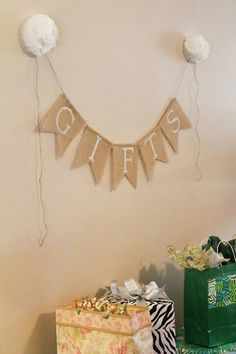 Rustic Bridal Shower: Burlap gifts banner with coffee cup liner flowers as accents.