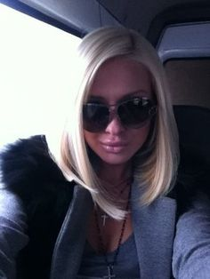 Gorgeous platinum blonde with a long face-framing angled bob hairstyle. L♥Ve it!
