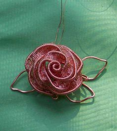THIS is impressive! Unfortunately, you have to pay for the tutorial. 2nd Rose   JewelryLessons.com