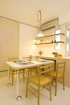 Ingenious Design Solutions in a Cozy 39 Square Meter Apartment-roll out dining table