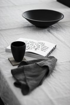 Beautiful shot. Grey on grey different tones lived in space book with writing to set theme? Ceramics.
