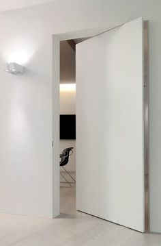 White pivoting door.