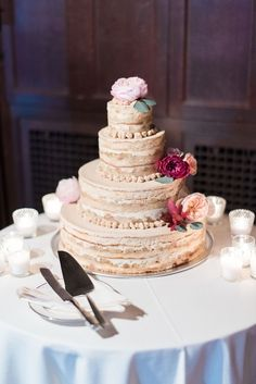 Now this is how you do a naked cake! With blush and red florals. See more here: http://www.doublegevents.com/blog/whimsical-wedding-at-waveny-house-rachel-rob
