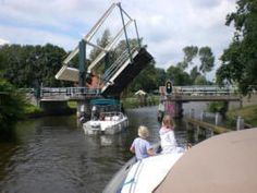 Crossing a bridge with our rental boat in the Frisian Lake District in Holland