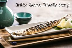 Grilled Sanma (pacific saury) over charoal, served with grated daikon and lemon. Classic Japanese fall dish.