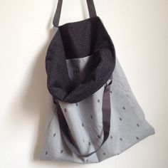 Image of hand printed carry-all tote with vintage wool lining, trees and arrows pattern