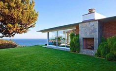 Photos via Realtor.com In August, news broke that actor Brad Pitt had put his four-bedroom, 4,000-square-foot midcentury Malibu, Calif., manse on the market...