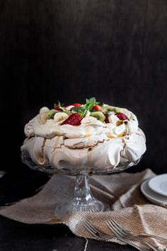 Easy Australian Pavlova is all about that crunchy, crumbly meringue shell and soft, pillowy marshmallow centre, topped with lashings of sweet cream and fruit. Australian Pavlova Recipe, Australian Desserts, Meringue Pavlova, Meringue Food, Mini Pavlova, Cake Recipes, Dessert Recipes, Christmas Desserts, Tray Bakes