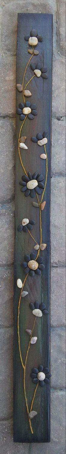 Pebble Art / Rock Art string of black flowers on reclaimed wood, approx. 30x4 inch (FREE SHIPPING) by CrawfordBunch on Etsy https://www.etsy.com/listing/241613378/pebble-art-rock-art-string-of-black