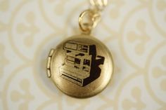 Kid's Locket with Camera Image, Gold Necklace, Photographer's Polaroid Pendant, Photography Jewelry, 14kt Gold Filled Chain, Small Charm by FreshyFig on Etsy https://www.etsy.com/listing/87681342/kids-locket-with-camera-image-gold