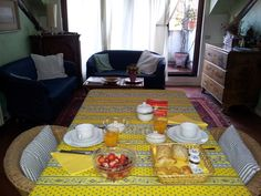 Breakfast table in our living room. You can have breakfast outside in the balcony or in your room. Breakfast is Italian style with fresh squeezed orange or grapefruit juice, fresh fruits, yogurt, crispy oven baked rolls, croissant & chocolate cakes, jam & butter, hot drinks (coffee, tea, milk ...).