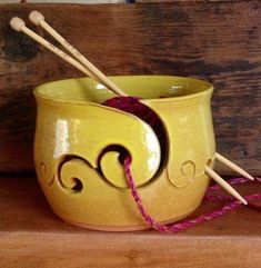 Hand thrown mustard yellow yarn bowl with simple scroll yarn feed. Made in terracotta clay. This simple yet attractive bowl is designed to keep Ceramics Projects, Clay Projects, Clay Crafts, Yarn Crafts, Thrown Pottery, Pottery Bowls, Ceramic Pottery, Ceramic Clay, Ceramic Bowls