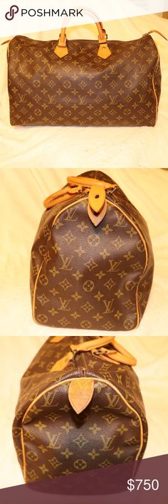 100% Louis Vuitton Speedy 40 Boston Travel Bag The iconic Speedy is always in fashion and suitable for a variety of occasions. Simple and easy to carry, this large handbag makes getting around town with all the essentials a pleasure. - Golden color metallic pieces - Elegant hand carry - Zip closure  - Rounded handles and trimmings in natural cowhide leather - Generous capacity Does not include lock. Louis Vuitton Bags Travel Bags
