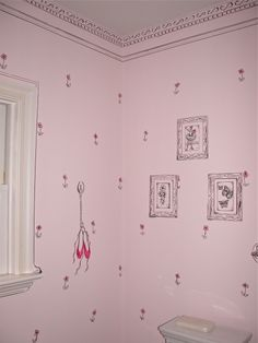 This wonderfully girlie room was accomplished with just a sharpie and pink paint