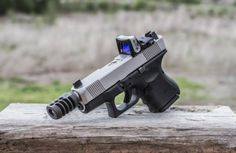 Custom Lone Wolf Glock 27 .40 S&W with Trijicon RMR slide melt and compensator.