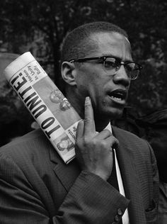 """Malcolm X gives the finger """""""
