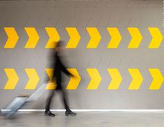 EchoPanel Direction self adhesive acoustic tiles in yellow and grey, made from 60% recycled plastic bottles and double up as a pinboard wall