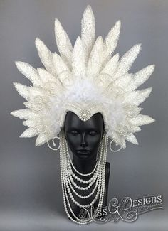 READY TO SHIP AFTER JANUARY 3RD SHE HAS A PHOTO SHOOT PLANNED  This headdress is made with off white faux feathers. Accented with various white