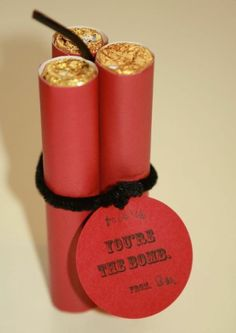cute valentine - looks like it's red construction paper rolls and rolos in them? That would be cute.