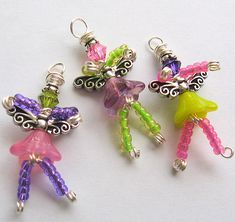 """Just finished these little cuties up last night!  Each fairy measures approximately 1 1/8"""" (28mm) tall from the bottom of their feet to the top of the wire wrapped loop. All were handmade using non-tarnish wire, along with a variety of seed beads, crystals, and glass beads."""