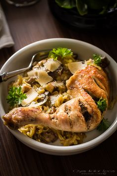 Baked orzotto with mushroom and chicken legs
