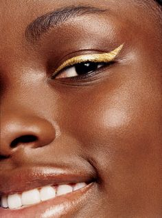 Loving gold eyeliner atm... and this girls face is gorgeous! Smile, eyes & cheeks.. so pretty!