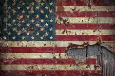 flag of the united states on a vintage tin background