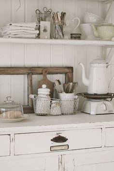 OPEN KITCHEN SHELVING :: Swedish decor...love the mason jars filled w/ vintage scissors & knives. The combo of white, wood, metal, glass & enamelware is perfect.