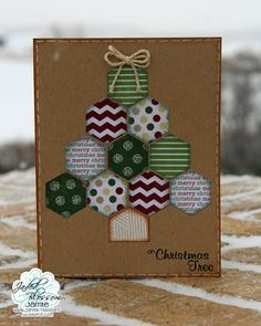 """Simple hexagon shapes cut from the Mini Tag Dies form a cute Christmas tree on this handmade card.  Using a variety of colors and patterns along with traditional """"merry christmas"""" paper allow you to exert maximum creativity."""