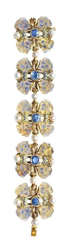 René Lalique | Art Nouveau bracelet -  circa 1900. Gold, sapphires, moulded glass, enamel and pearls.