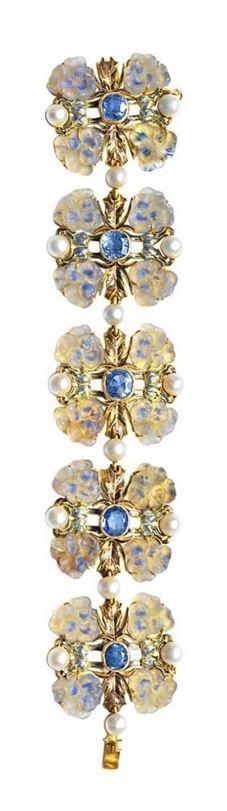 René Lalique | Art Nouveau bracelet -  circa 1900. Gold, sapphires, moulded glass, enamel and pearls.